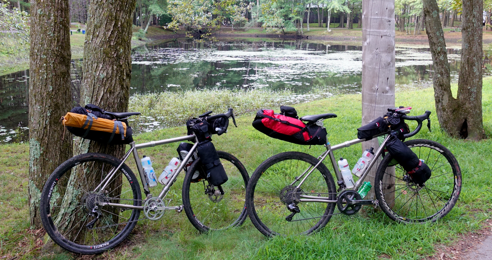 gravel bikepacking by a pond's edge