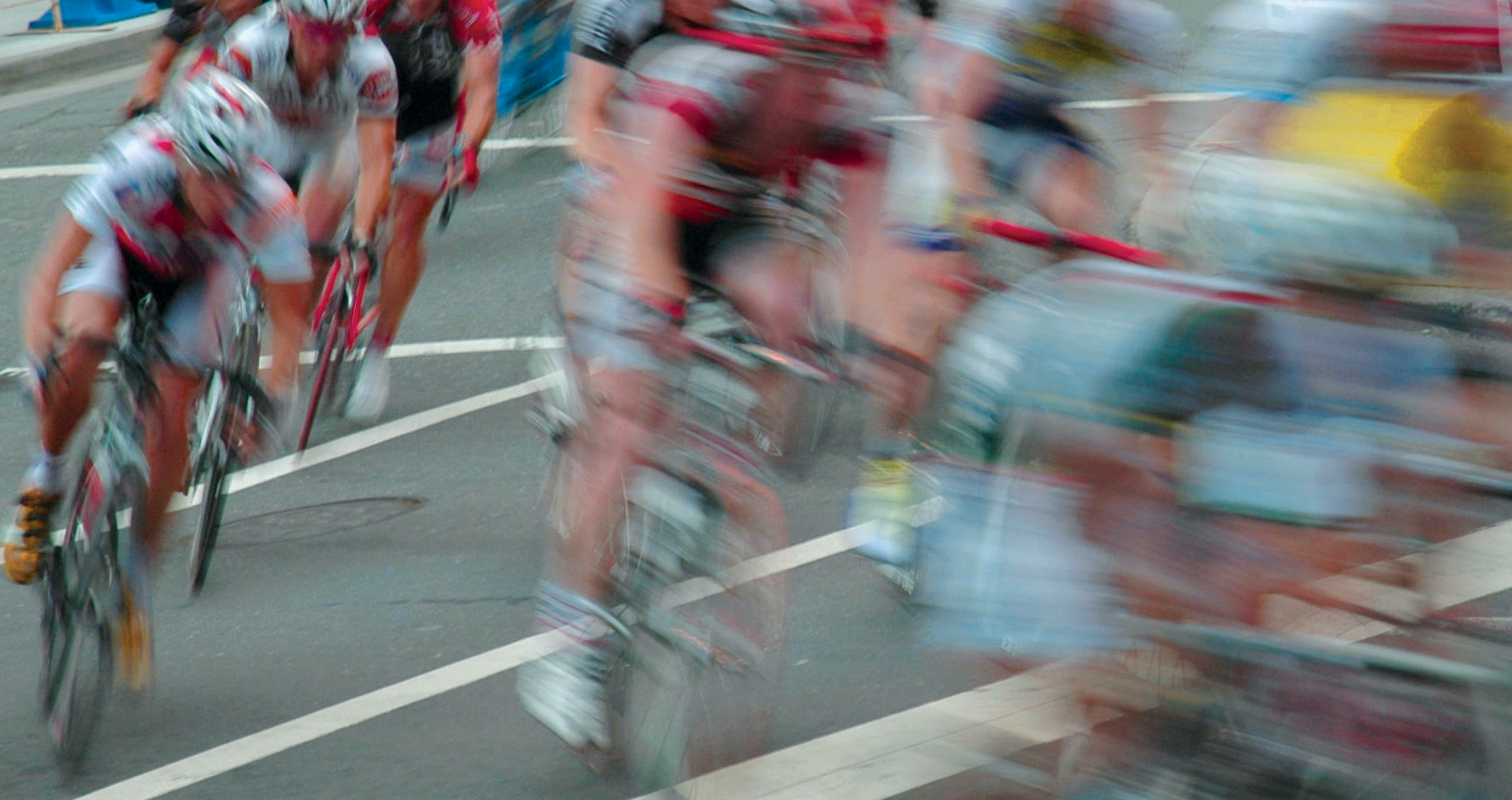 a pack of road cyclists in a race