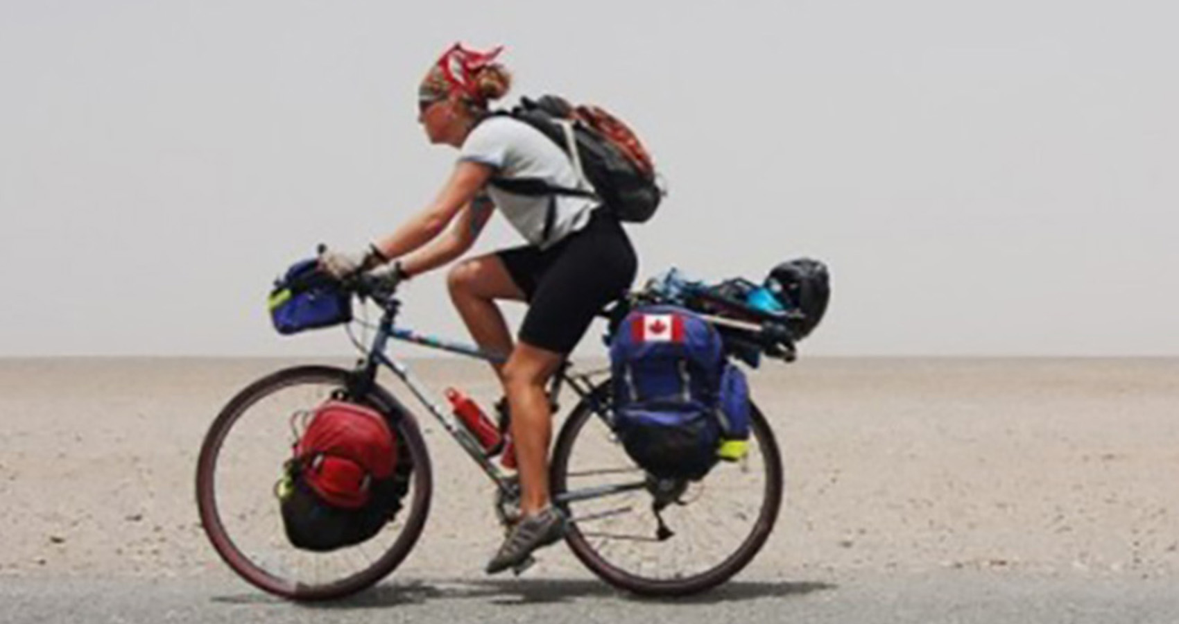 fully loaded bicyle crossing the desert