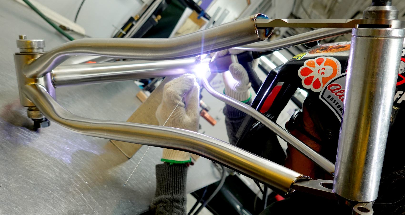 Stef welds the seatstays on a titanium bicycle frame